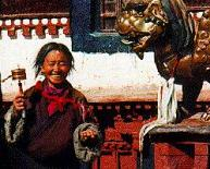 Tibetan woman offering prayer